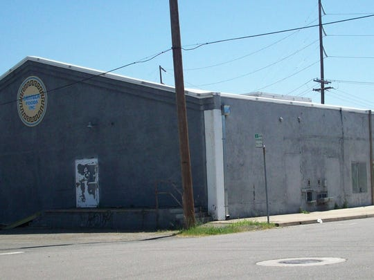 This file photo of the former Redding Ice House shows the self-serve ice station on the right of the building where customers could drop coins in a slot and get ice. The building was later home to Canteca Foods, and was destroyed by fire in July 2012.