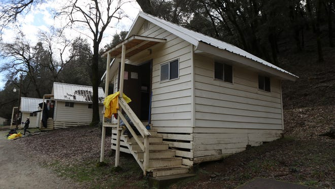 Cabins are cleaned Friday after high creek flows caused Whiskeytown Environmental School to be evacuated Thursday night.