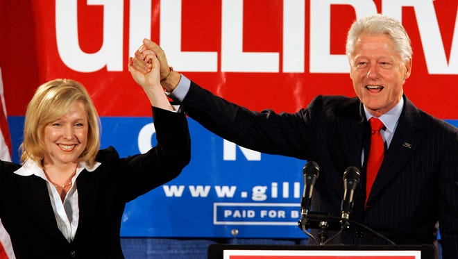 In this Oct. 26, 2006, file photo, former president Bill Clinton holds up the hand of Kirsten Gillibrand, a Democratic lawyer who was running against three-term Rep. John Sweeney, R-N.Y., at a rally in Albany, N.Y. U.S. Sen. Kirsten Gillibrand said, in an interview in The New York Times on Thursday, Nov. 16, 2017, that former president Clinton should have resigned over his sexual affair with White House intern Monica Lewinsky 20 years ago.