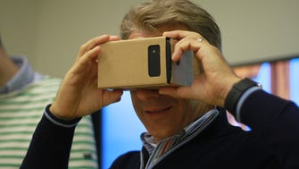 USA TODAY tech writer Marco della Cava views a Jump virtual-reality video through Google's latest Cardboard VR platform, which turns any smartphone into a 3D viewing device.