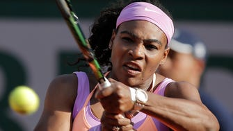 Serena Williams of the U.S. returns in the third round match of the French Open against Victoria Azarenka of Belarus at the Roland Garros stadium, in Paris, May 30, 2015.