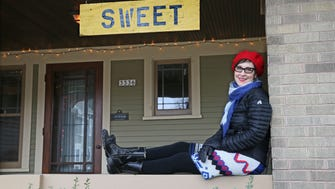 "Debra Pyne put a sign on the front of her house that said ""SWEET.""  It was an antique farm sign that was used to sell sweet corn. Her neighbors have responded over the months with their own signs. Among them, ""Sweetness,"" ""Sweeter,"" ""Sweetest"" and ""Spicy."" They are all in the 3300 block of S. New York Ave. in Milwaukee."