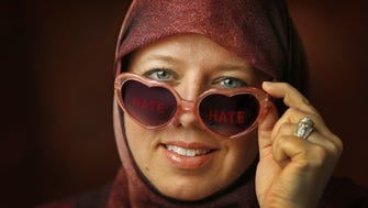 Tara Ijai is a Muslim woman who started wearing heart-shaped glasses as a way reminding herself to see the love, not the hate. (Photo illustration)