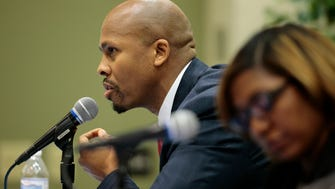 Candidate Rob Richardson leans in as he answers a question during the 2017 Mayoral Forum hosted by the Cincinnati NAACP and Prince Hall Masons at the Community Acton Agency in the Bond Hill neighborhood of Cincinnati on Tuesday, March 28, 2017.