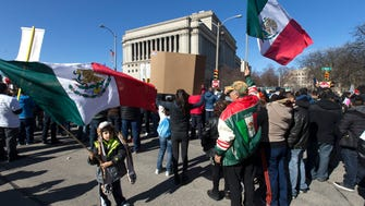 "Thousands of people take part in the ""Day Without Latinos, Immigrants and Refugees"" march and demonstration Feb. 13 in Milwaukee."