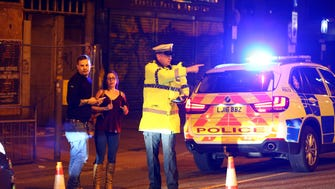 Police stand by a cordoned off street close to the Manchester Arena in Manchester, England. There have been reports of explosions at Manchester Arena where Ariana Grande had performed this evening.