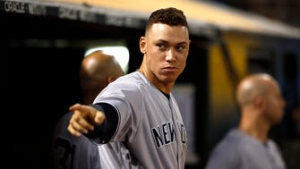 Yankees outfielder Aaron Judge (99) reacts after the Yankees scored a run to tie the game against the Oakland Athletics in the seventh inning at Oakland Coliseum on Thursday, June 15, 2017. The A's won the game 8-7 in 10 innings.