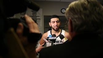 Xavier Musketeers forward Kerem Kanter (11) talks to the media after the game.