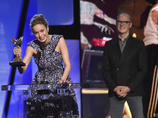 """Brie Larson accepts the award for best female lead for """"Room"""" at the Film Independent Spirit Awards."""