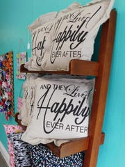 Pillows with phrases are one of the offerings at Kay & Ken's Boutique.