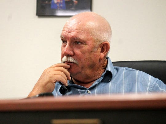 County Commissioner Ronny Rardin listens to a presentation by Dan Abercrombie on the New Mexico meadow jumping mouse at the county's regular commission meeting Thursday morning.