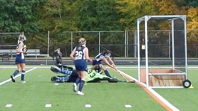 Gardner High goalkeeper Devyn Goyette (93) dives but can't prevent Quabbin's Jorji LaViolette from doubling the Panthers' lead with 5 seconds left in the first quarter of Monday's field hockey game at Watkins Field in Gardner. The visiting Panthers won, 3-0.