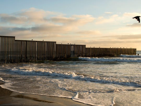 The fence separating the United States from Mexico stretches into the Pacific Ocean south of San Diego.