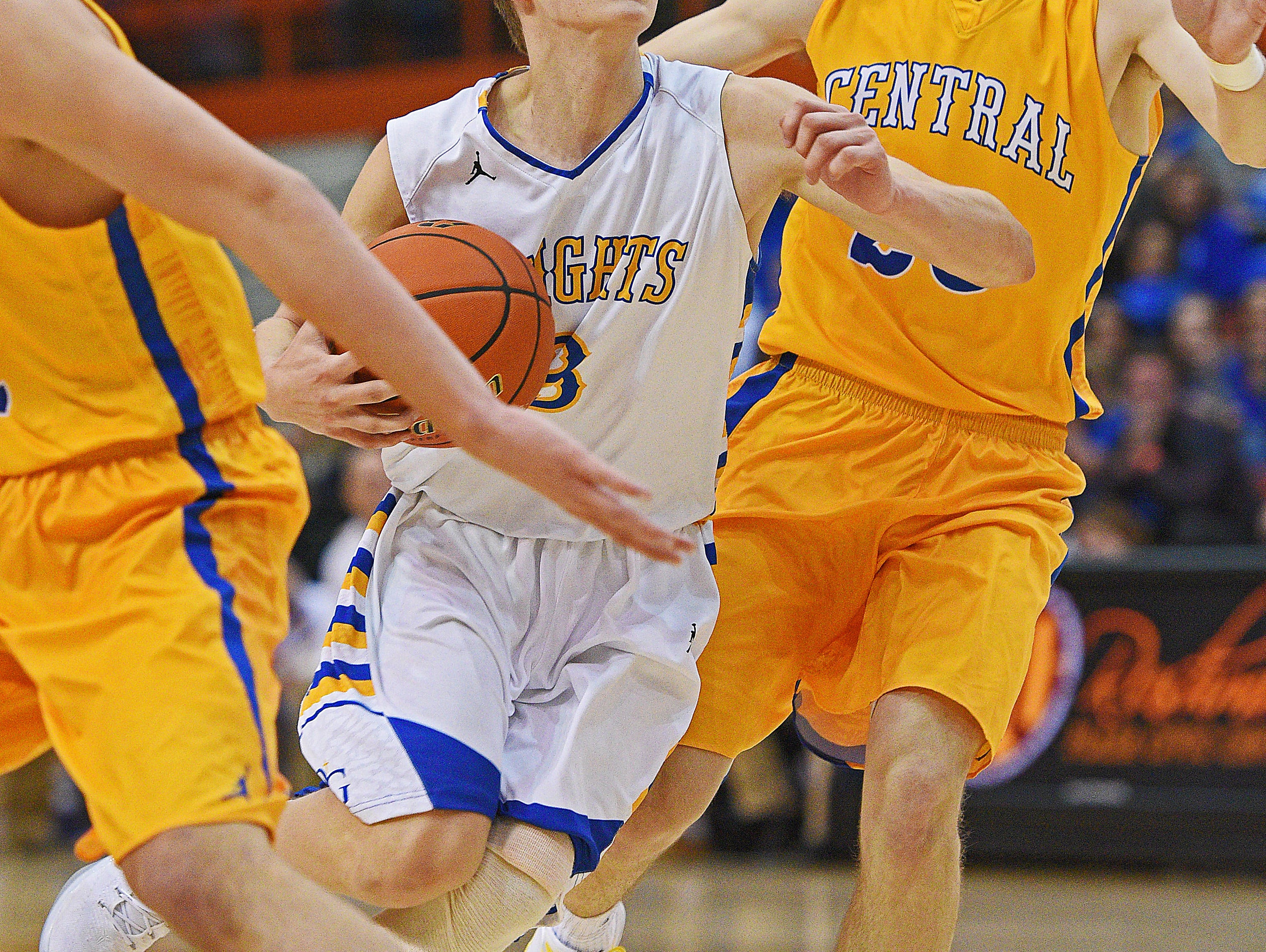 O'Gorman's Louis Peterson (3) dribbles past Aberdeen Central's Jonah Dohrer (20) during the 2017 SDHSAA Class AA State Boys Basketball championship game Saturday, March 18, 2017, at Rushmore Plaza Civic Center in Rapid City.