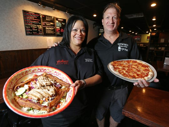 Patty Cinelli-Fallon and David Sturrock, co- owners of Gatwyns II Restaurant, a 19-year-old classic American pub located in Jefferson. August 3, 2016, Jefferson, NJ