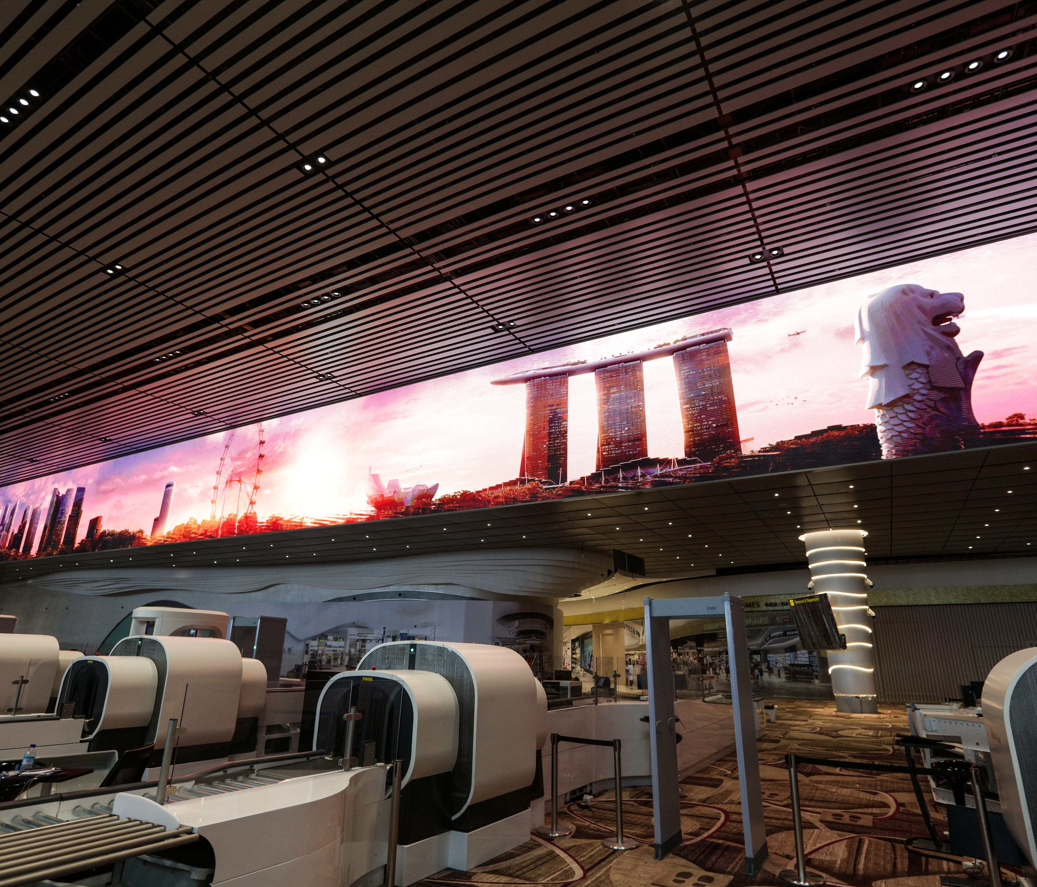 LED Immersive Wall behind security checkpoint at Changi T4 has 50 minutes worth of images and animated content.