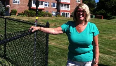 South Nyack Mayor Bonnie Christian next to a village-installed noise monitor at Salisbury Point condominiums on Aug. 28.