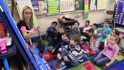 Student teacher Samantha Felder works with first-graders at the Park Avenue School in Port Chester on Feb. 27. She is completing a master's degree at Manhattanville College and is preparing for a new exam to get her initial state certification to teach.