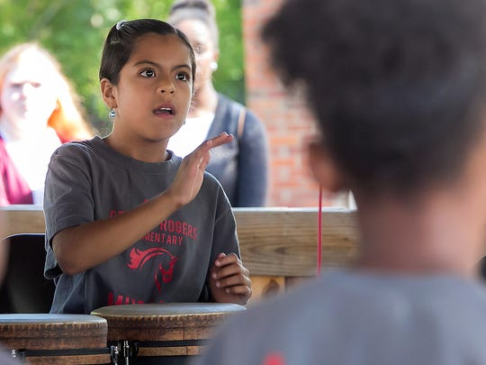 Brisa Barreto plays drums along with classmates from Reeves Rogers Elementary at the Boro International Festival at Cannonsburgh Village.