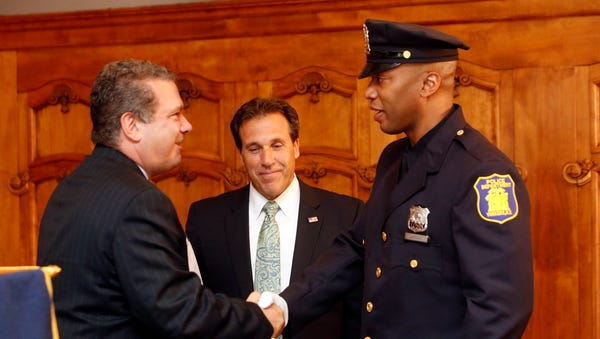 Mayor Mike Spano, left, congratulates Police...