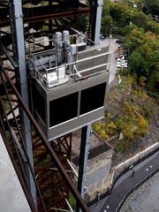 The Walkway elevator begins its descent toward Upper Landing Park. The custom-built elevator takes about 76 seconds to travel 21 stories, or about 210 feet, from the Walkway platform to ground level.