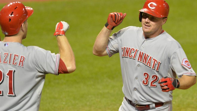 Cincinnati Reds right fielder Jay Bruce (32) celebrates with third baseman Todd Frazier after hitting a solo home run in the ninth inning against the Cleveland Indians at Progressive Field in August of 2014.