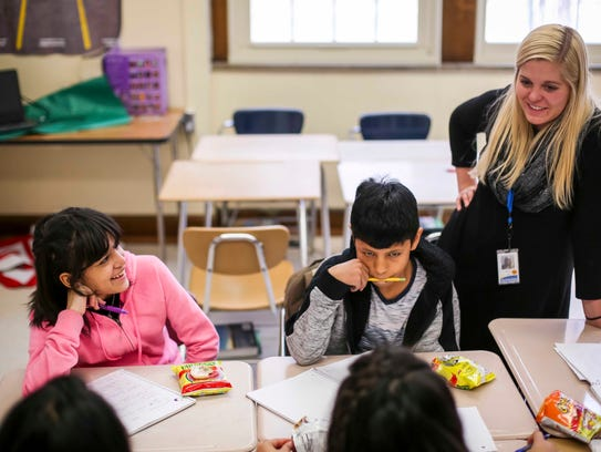 Paola Rios Rosario talks with students in Nicole Ellis' class Dec. 20 at Lincoln High School in Des Moines. Rosario arrived from Toa Baja, Puerto Rico, in November after Hurricane Maria devastated her hometown.