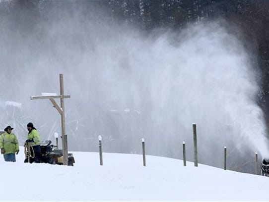 In this Tuesday, Nov. 18, 2014 photo, a snowmaking