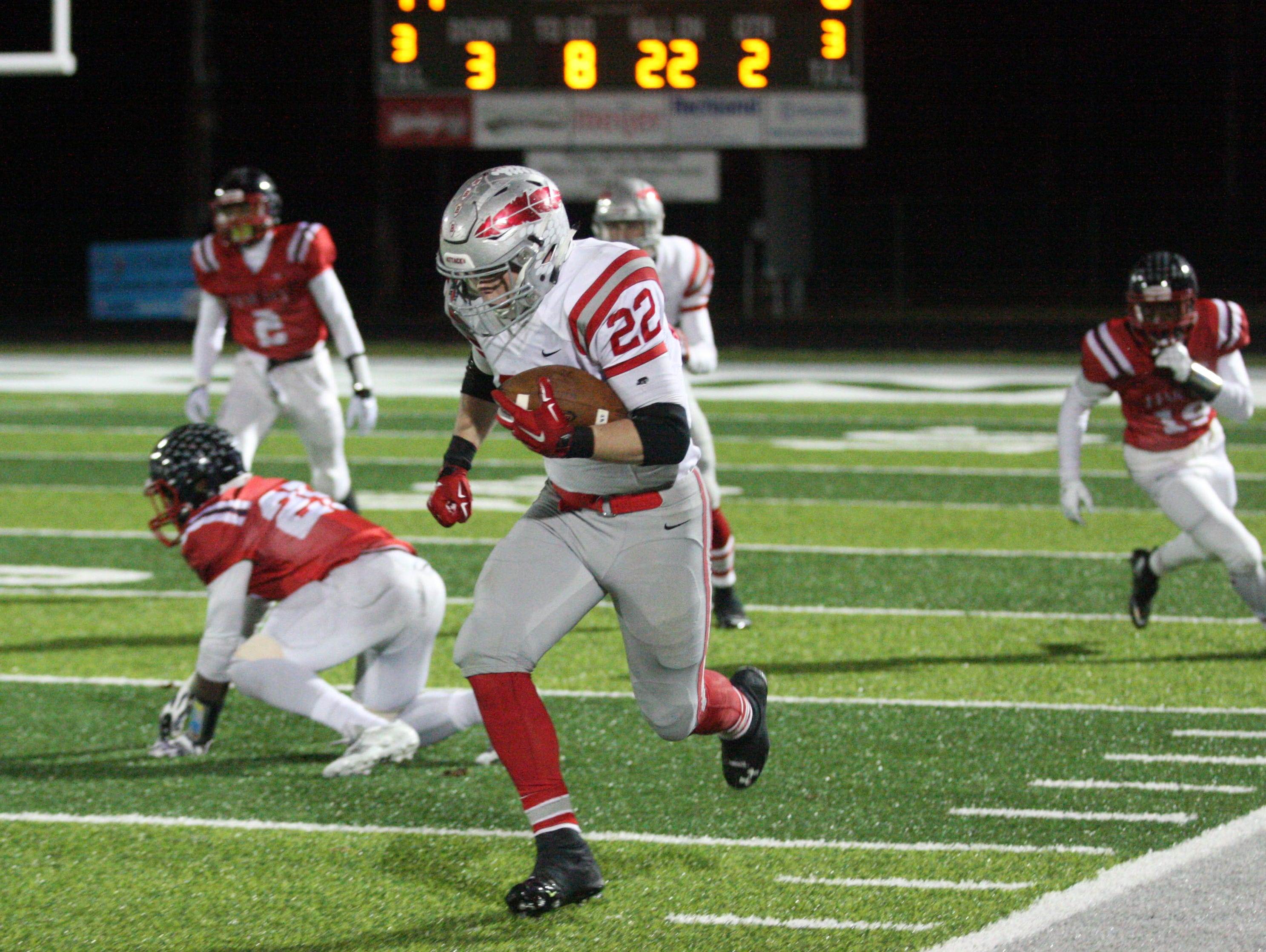 Bellevue's Bryce Ray catches a tipped ball and races 78 yards for a touchdown Saturday.