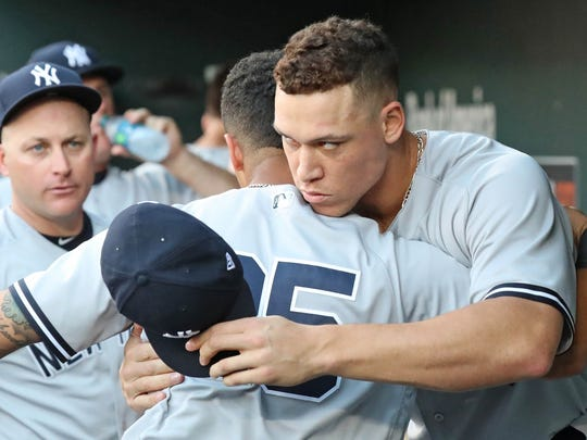 New York Yankees outfielder Aaron Judge (99) greets