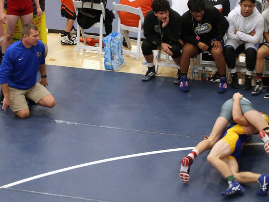 Bremerton wrestling coach Ty Michaelson looks on from