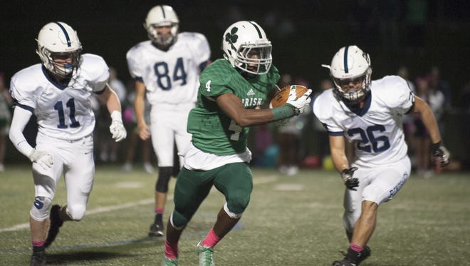 Camden Catholic's Kyle Dupree looks for running room during a first-half punt return.