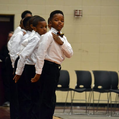 A group of 8-12 year olds, known as the Boys II Bow
