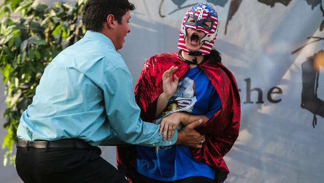 """Actor Wade Sorrells and Chris Elliot practice a fight scene for the Shakespeare on the Concho production of """"As You Like It"""" Wednesday, June 7, on the lawn of the San Angelo Museum of Fine Arts."""