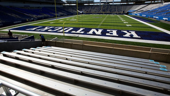 The new UK football recruiting room at Commonwealth Stadium has a deck overlooking the field and the seats the recruits sit in for the game. 