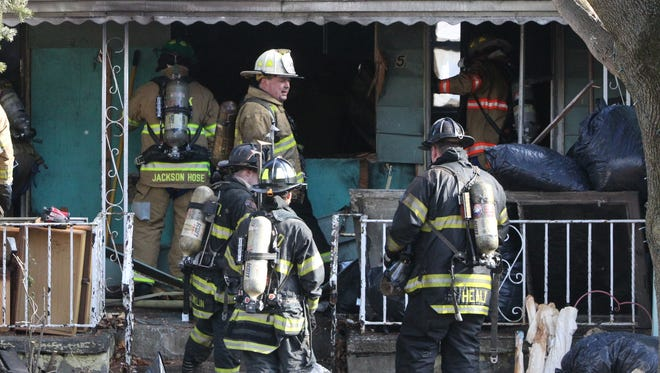 Firefighters work to control a fire at a Toto Ct., Nyack house Dec. 15, 2016. The residents of the house had been ordered out of the house earlier in the week because of large amounts of debris in the house.