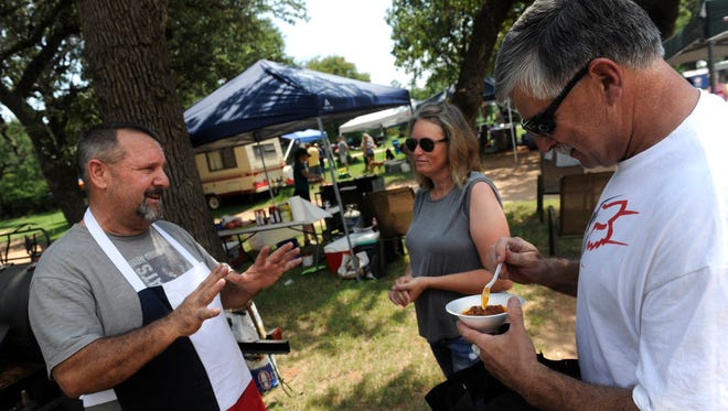 Jim Boisey (right) tries Joe Lamson's chili as his wife Sherry listens to the cook explain his recipe during Saturday's Chili Superbowl and Cookoff in Buffalo Gap Sept. 2, 2017.