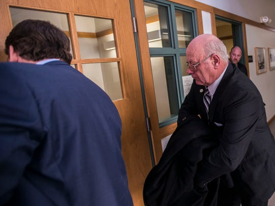 Former Vermont State Sen. Norm McAllister arrives at Vermont Superior Court in St. Albans to contest a 'no contest' plea he made in January to lewd and lascivious conduct and two counts of prohibited acts just before his trial was to begin. McAllister says he felt forced into the deal by his lawyers and didn't understand what he was pleading to.