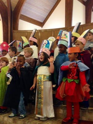 St. Frances Cabrini School kindergarten and pre-kindergarten students sing a song to the saints after Mass on Friday for All-Saints Day. Students dressed as saints on top of their Halloween costumes they could wear to school.