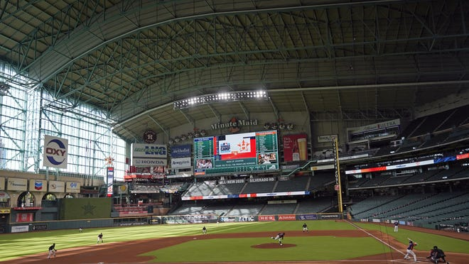 Get used to this, baseball fans. Major league baseball has returned, and the games will be played with empty stands. They will look like this July 13 Houston Astros intrasquad game inside Minute Maid Park.