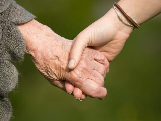 Holding hands of grandmother and child, closeup.