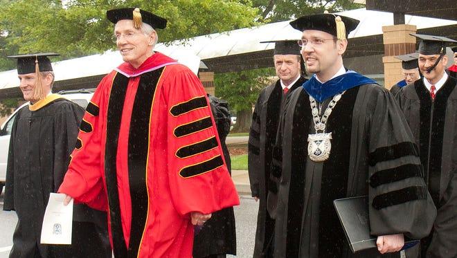 Bob Jones III, in red, and his son, Stephen Jones, before Bob Jones University's graduation in May 2013.