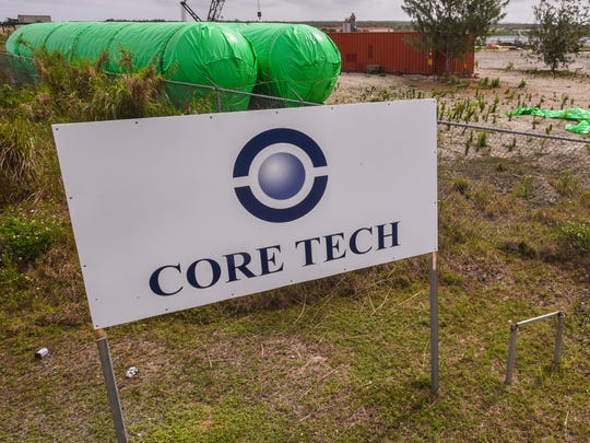 This Feb. 28, file photo shows a Core Tech sign posted outside a fenced enclosure storing construction equipment and material in` the Harmon cliff line area.