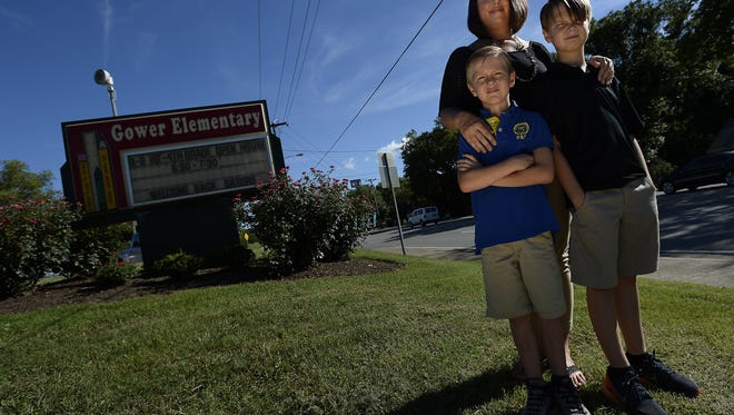 Sarah Galloway is concerned about the Nashville Metro Public Schools bus transportation issues. Some school bus routes are still not coordinated to pick up all of the students who need transportation. She is standing with her sons, Chandler, left, who attends Gower Elementary School, and Will, who goes to H.G. Hill Middle School to school on Tuesday, August 9, 2016, in Nashville, Tenn.