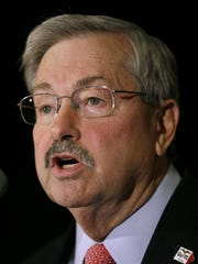 Iowa Gov. Terry Branstad parried entertainer Cher's comments about the use of pig crates.