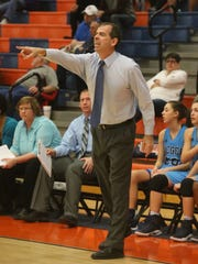 Siegel coach Alan Bush directs his team during the District 7-AAA tournament. Bush resigned following the season.