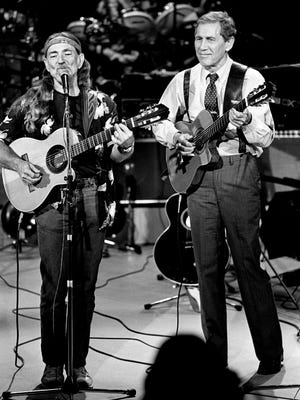 """Back by Chet Atkins, right, and an all-star band, Willie Nelson is performing during the taping of """"Chet Atkins & Friends,"""" a Cinemax TV special, at Vanderbilt University's Neely Auditorium May 2, 1987. Atkins was head of RCA Records in Nashville during Nelson's tenure with the label."""