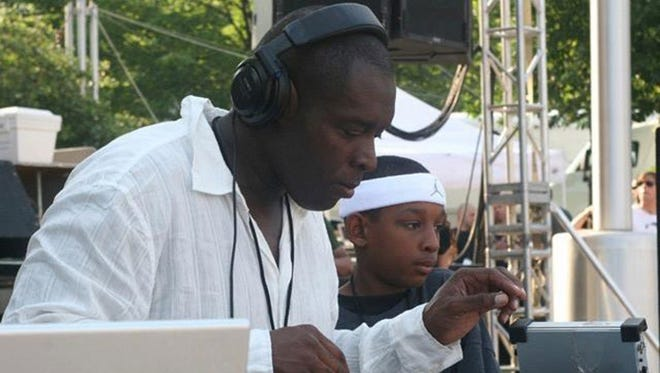 Kevin Saunderson and his son Dantiez Saunderson perform at a techno festival  in Detroit's Hart Plaza.
