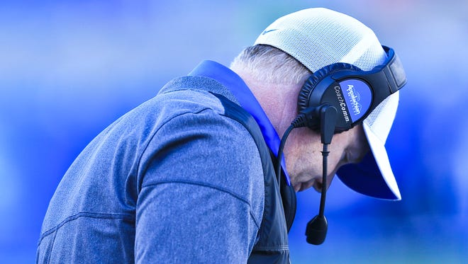"Head coach Mark Stoops glumly looks on as Louisville easily beat Kentucky 44-17 Saturday Nov. 25 at Kroger Field. ""I can't recall defending anybody as talented as he is,"" Stoops said, describing Lamar Jackson."
