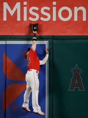 Los Angeles Angels' Kole Calhoun catches the ball hit
